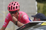 Tejay Van Garderen of the U.S. is treated by a medic after he crashed during the seventh stage of the Tour de France cycling race over 230 kilometers (142,9 miles) with start in Belfort and finish in Chalon sur Saone, France, Friday, July 12, 2019. (AP Photo/Thibault Camus)