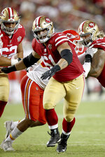 """FILE - In this Saturday, Aug. 14, 2021, file photo, San Francisco 49ers Dakoda Shepley (61) looks to block during an NFL football game against the Kansas City Chiefs in Santa Clara, Calif. Despite an NFL career lacking notoriety to date, Shepley has a claim no one else in football can match: He was in the movie """"Deadpool 2"""" portraying comic book villain Omega Red on the big screen(AP Photo/Scot Tucker)"""