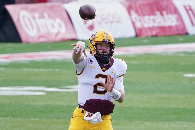 FILE - Minnesota quarterback Tanner Morgan (2) throws during the first half of an NCAA college football game against Nebraska in Lincoln, Neb., Saturday, Dec. 12, 2020. Many of Minnesota's upperclassmen cashed in on the bonus year of eligibility after the pandemic and returned for 2021, giving the Gophers one of the oldest teams in the Big Ten. The time is now for coach P.J. Fleck's group to take another step forward, led by running back Mo Ibrahim and quarterback Tanner Morgan, both in their fourth year. (AP Photo/Nati Harnik)
