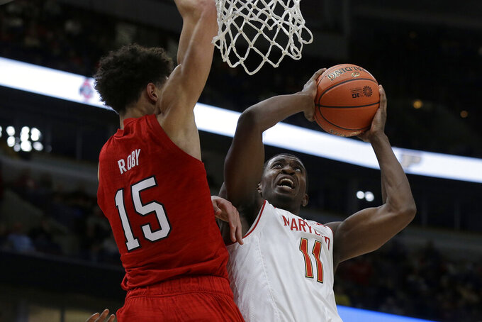 Maryland's Darryl Morsell (11) shoots against Nebraska's Isaiah Roby (15) during the first half of an NCAA college basketball game in the second round of the Big Ten Conference tournament, Thursday, March 14, 2019, in Chicago. (AP Photo/Kiichiro Sato)