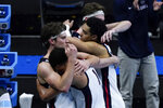 Gonzaga guard Jalen Suggs (1) gets a hug from teammate forward Corey Kispert, left, at the end of the championship game against Baylor in the men's Final Four NCAA college basketball tournament, Monday, April 5, 2021, at Lucas Oil Stadium in Indianapolis. Baylor won 86-70. (AP Photo/Michael Conroy)