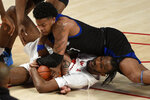 Houston guard DeJon Jarreau, bottom, and Tulsa guard Elijah Joiner scramble for a loose ball during the second half of an NCAA college basketball game Wednesday, Jan. 20, 2021, in Houston. (AP Photo/Eric Christian Smith)