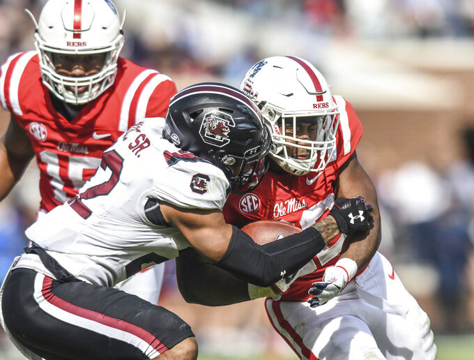 South Carolina defensive back Steven Montac (22) tackles Mississippi running back Scottie Phillips (22) during an NCAA college football game at Vaught-Hemingway Stadium in Oxford, Miss. on Saturday, Nov. 3, 2018. (Bruce Newman/The Oxford Eagle via AP)