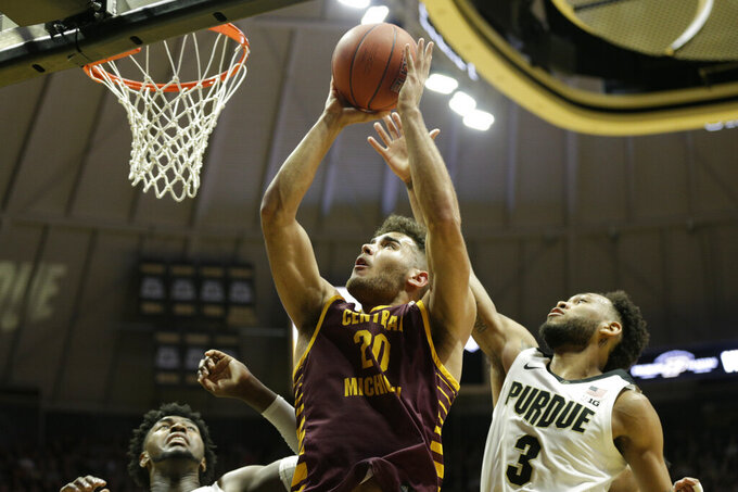 Central Michigan guard Kevin McKay (20) goes up for two during the first half of an NCAA college basketball game in West Lafayette, Ind., Saturday, Dec. 28, 2019. (Nikos Frazier/Journal & Courier via AP)
