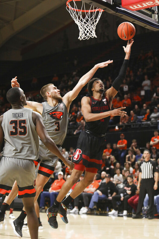 Stanford's Bryce Wills (2) shoots around Oregon State's Tres Tinkle (3) and Dearon Tucker (35) during the first half of an NCAA college basketball game in Corvallis, Ore., Thursday, March 5, 2020. (AP Photo/Amanda Loman)