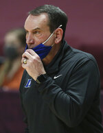 Duke coach Mike Krzyzewski watches during the second half of the team's NCAA college basketball game against Virginia Tech on Tuesday, Jan. 12, 2021, in Blacksburg, Va. (Matt Gentry/The Roanoke Times via AP, Pool)