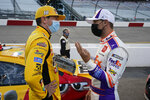 Kyle Busch, left, and Denny Hamlin talk prior to the start of a NASCAR Cup Series auto race Saturday, Sept. 12, 2020, in Richmond, Va. (AP Photo/Steve Helber)