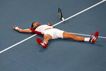 Novak Djokovic of Serbia falls to the ground after defeating Daniil Medvedev of Russia during their ATP Cup semifinal tennis match in Sydney, Saturday, Jan. 11, 2020. (AP Photo/Steve Christo)
