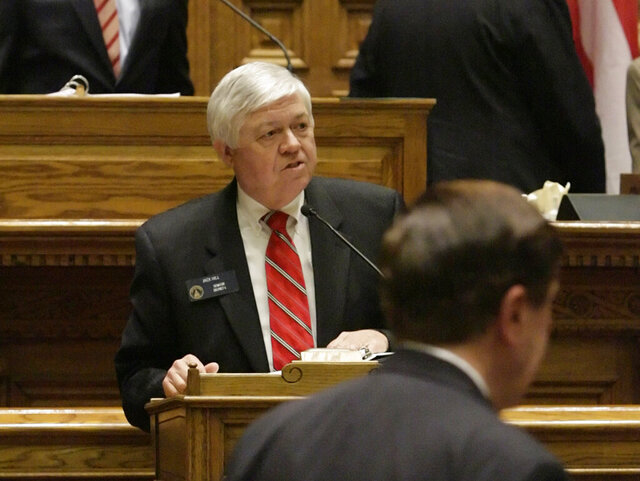 """FILE - In this April 3, 2009, file photo, Georgia Sen. Jack Hill, R-Reidsville, addresses fellow legislators about the state budget bill from the lower podium in the senate chamber during the last day of the legislative session in Atlanta. The Georgia Senate on Wednesday, Feb. 4, 2020, passed its version of midyear budget cuts in a nearly unanimous vote, approving a plan to cut $159 million in state spending for the fiscal year that ends June 30. """"This is a budget with few real adds, frankly,"""