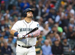 Seattle Mariners' Daniel Vogelbach watches his two-run home run during the fourth inning against the Oakland Athletics in a baseball game Saturday, July 6, 2019, in Seattle. (AP Photo/Lindsey Wasson)