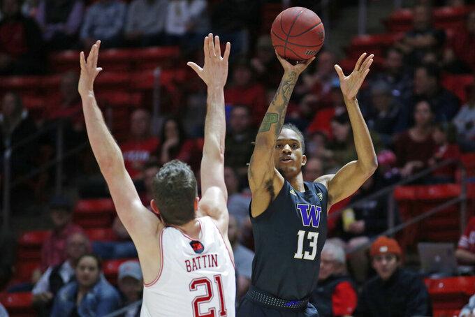 Washington forward Hameir Wright (13) shoots Utah forward Riley Battin (21) defends in the first half during an NCAA college basketball game Thursday, Jan. 23, 2020, in Salt Lake City. (AP Photo/Rick Bowmer)