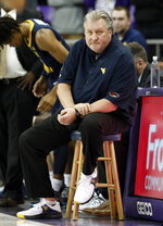 West Virginia head coach Bob Huggins watches play against TCU in the first half of an NCAA college basketball game, Tuesday, Jan. 15, 2019, in Fort Worth, Texas. (AP Photo/Tony Gutierrez)