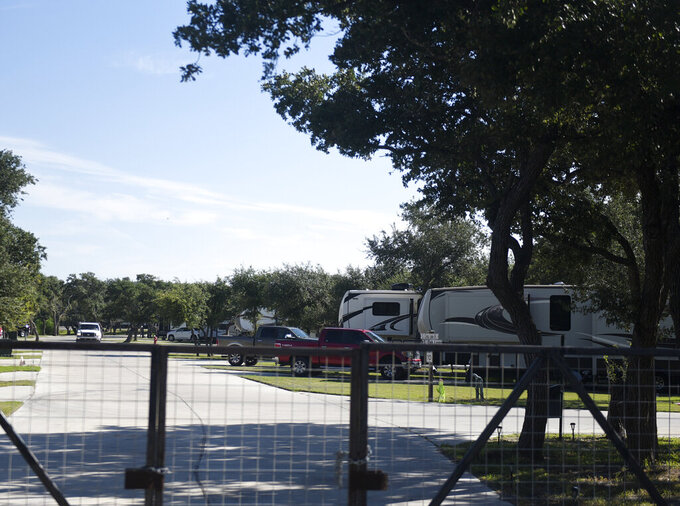 This Thursday, Sept. 16, 2021 photo shows the outside of the Aransas Oaks RV in Ingleside, Texas.  A teen who said he killed his family and posted graphic images of their bodies on social media killed himself after officers found him at his home, authorities said Thursday. Law enforcement agencies late Wednesday night tracked the teen to a recreational vehicle park near Aransas Pass. Officers asked him to step outside of his motor home, but he refused. Officers then heard a single gunshot and the sound of a person falling to the ground, police said. (Annie Rice/Corpus Christi Caller-Times via AP)