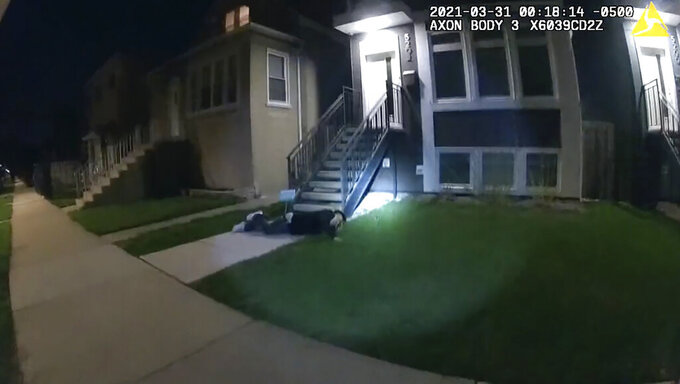 In this image taken from Chicago Police body cam video from early Wednesday, March 31, 2021, Anthony Alvarez lies on the ground after a police foot chase in Chicago. Alvarez was fatally shot by police during the incident. Police claim Alvarez, 22, brandished a gun while being chased. (Civilian Office of Police Accountability via AP)