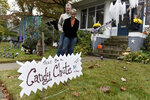 Carol McCarthy and her husband, Tom, pose for a portrait at their home they decorated for Halloween, Monday, Oct. 26, 2020, in Palmyra, N.J. (AP Photo/Michael Perez)