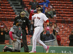 Boston Red Sox's J.D. Martinez, right, celebrates his two-run home run as he arrives at home plate as Seattle Mariners catcher Omar Narvaez, left, looks on in the eighth inning of a baseball game at Fenway Park, Sunday, May 12, 2019, in Boston. (AP Photo/Steven Senne)