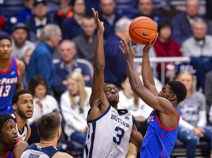 Butler guard Kamar Baldwin (3) tries to block the shot of DePaul guard Jalen Coleman-Lands (5) during the second half of an NCAA college basketball game, Saturday, Feb. 29, 2020, in Indianapolis. (AP Photo/Doug McSchooler)