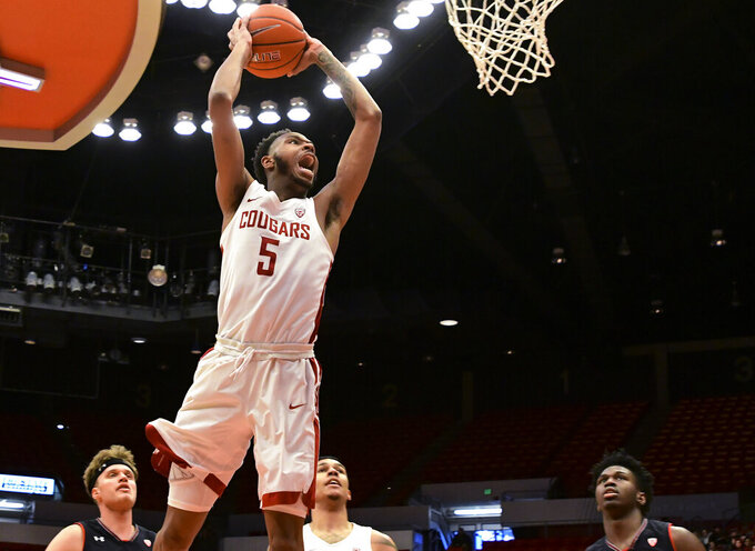 Washington State forward Marvin Cannon (5) goes up for a dunk against Utah during an NCAA college basketball game Saturday, Feb. 23, 2019, in Pullman, Wash. (Pete Caster/Lewiston Tribune via AP)