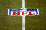 FILE - This Jan. 3, 2021, file photo, shows the NFL logo on the field before an NFL football game between the Denver Broncos and the Las Vegas Raiders in Denver. The NFL has informed teams they could potentially forfeit a game due to a COVID-19 outbreak among non-vaccinated players and players on both teams wouldn't get paid that week. Commissioner Roger Goodell said Thursday, July 22, 2021, in a memo sent to clubs that was obtained by The Associated Press that the league doesn't anticipate adding a 19th week to accommodate games that can't be rescheduled within the 18-week regular season. (AP Photo/Jack Dempsey, File)
