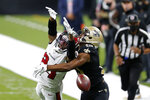 Tampa Bay Buccaneers cornerback Carlton Davis (24) breaks up a pass intended for New Orleans Saints wide receiver Michael Thomas (13) in the second half of an NFL football game in New Orleans, Sunday, Sept. 13, 2020. (AP Photo/Brett Duke)