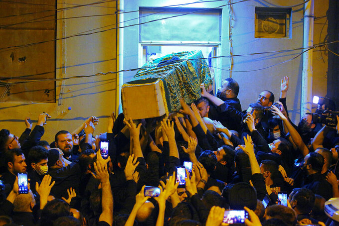 Mourners escort the coffin of Grand Ayatollah Sayyid Mohammed Saeed al-Hakim to his home in Najaf, Iraq, Friday, Sept. 3, 2021. Mohammed Saeed al-Hakim, one of Iraq's most senior and influential Muslim Shiite clerics, has died, members of his family said. He was 85. (AP Photo/Anmar Khalil)