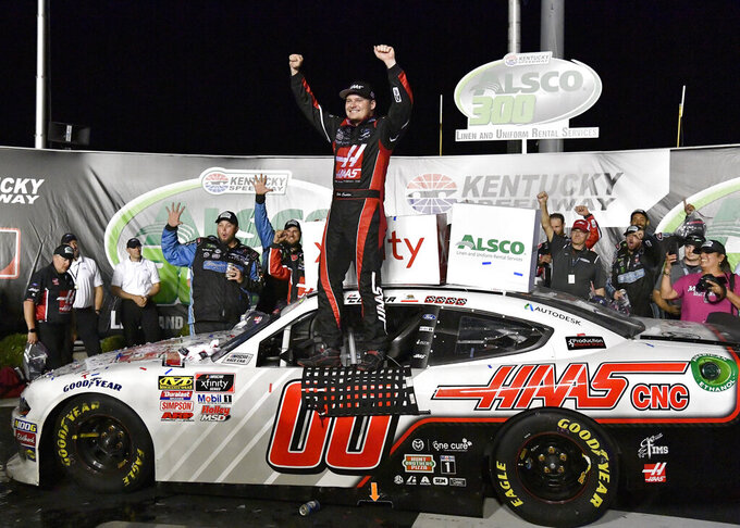 Cole Custer raises his hands after winning a NASCAR Xfinity Series auto race at Kentucky Speedway in Sparta, Ky., Friday, July 12, 2019. (AP Photo/Timothy D. Easley)