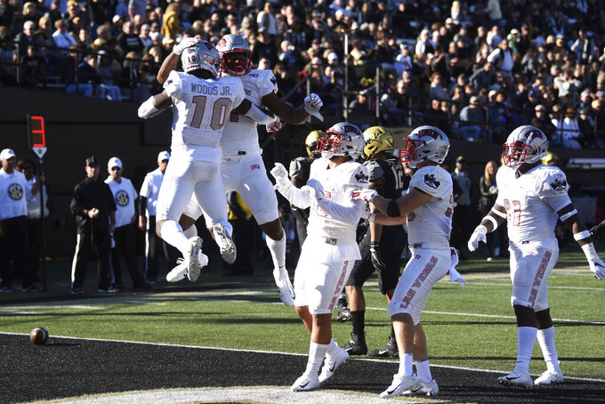 UNLV celebrates a touchdown against Vanderbilt in the first half of an NCAA college football game Saturday, Oct. 12, 2019, in Nashville, Tenn. (AP Photo/Mike Strasinger)