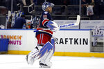 FILE - New York Rangers goalie Henrik Lundqvist celebrates his 400th career win after an NHL hockey game against the Colorado Avalanche in New York, in this Saturday, Feb. 11, 2017, file photo. Lundqvist, one of the greatest goaltenders of his generation, announced his retirement Friday, Aug. 20, 2021, less than nine months after heart surgery.  (AP Photo/Adam Hunger, File)