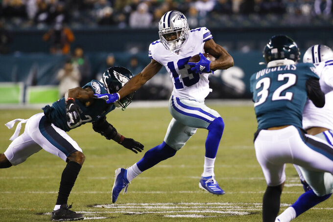 Philadelphia Eagles cornerback Jalen Mills, left, tries to stop Dallas Cowboys wide receiver Michael Gallup (13) during the first half of an NFL football game Sunday, Dec. 22, 2019, in Philadelphia. (AP Photo/Chris Szagola)