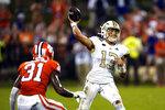 Georgia Tech quarterback Jordan Yates (13) throws a pass as Clemson cornerback Mario Goodrich (31) defends in the second half of an NCAA college football game, Saturday, Sept. 18, 2021, in Clemson, S.C. (AP Photo/John Bazemore)