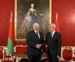 Belarusian President Alexander Lukashenko, left, shakes hands with Austrian President Alexander Van Der Bellen, right, ahead of their meeting in Vienna, Austria, Tuesday, Nov. 12, 2019. (AP Photo/Ronald Zak)