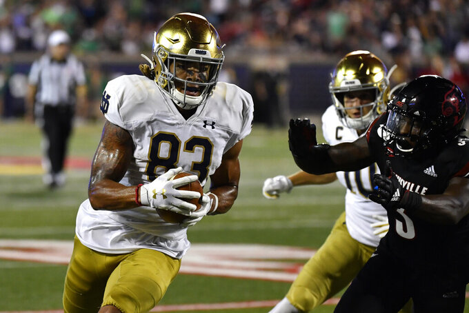Notre Dame wide receiver Chase Claypool (83) runs from the pursuit of Louisville defensive back Russ Yeast (3) during the second half of an NCAA college football game in Louisville, Ky., Monday, Sept. 2, 2019. Notre Dame won 35-17. (AP Photo/Timothy D. Easley)