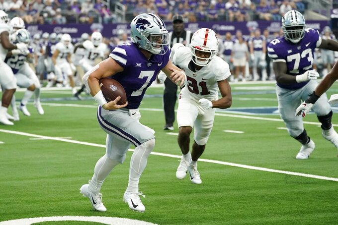 Kansas State quarterback Skylar Thompson (7) runs the ball as Stanford cornerback Zahran Manley (31) pursues in the second half of an NCAA college football game in Arlington, Texas, Saturday, Sept. 4, 2021. (AP Photo/Tony Gutierrez)
