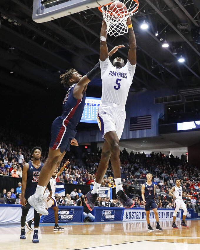 Prairie View A&M's Kevonte Corley (5) dunks against Fairleigh Dickinson's Elyjah Williams, left, during the second half of a First Four game of the NCAA college basketball tournament, Tuesday, March 19, 2019, in Dayton, Ohio. (AP Photo/John Minchillo)