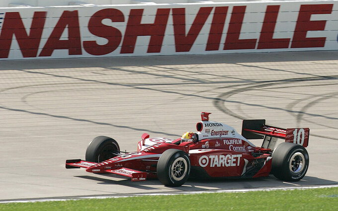 FILE - In this Friday, July 1, 2006, file photo, Dan Wheldon, of Great Britain, turns the fastest lap during qualifying of the IRL IndyCar Series' Firestone Indy 200 auto race at Nashville Superspeedway in Gladeville, Tenn. The IndyCar Music City Grand Prix on Sunday, Aug. 8, 2021, will zip through downtown streets in Nashville, past an NFL stadium and over the Cumberland River.  (AP Photo/John Russell, FIle)