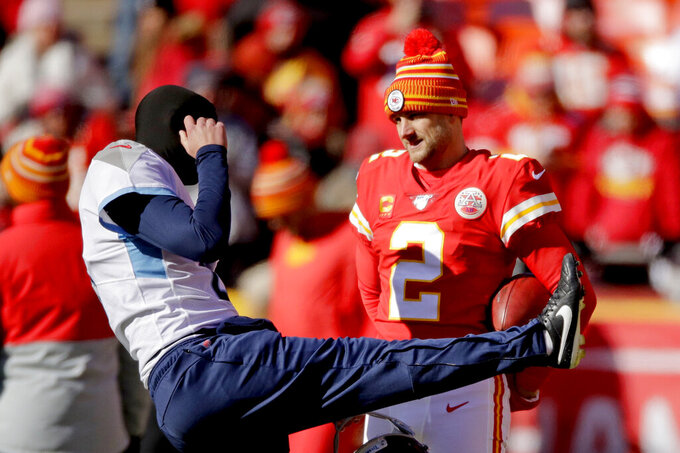 Kansas City Chiefs' Dustin Colquitt, right, talks to Tennessee Titans' Brett Kern before the NFL AFC Championship football game Sunday, Jan. 19, 2020, in Kansas City, MO. (AP Photo/Charlie Riedel)