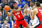 Mississippi's Blake Hinson (0) looks for a teammate while defended by Kentucky's Immanuel Quickley, right, in the first half of an NCAA college basketball game in Lexington, Ky., Saturday, Feb. 15, 2020. (AP Photo/James Crisp)