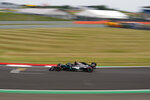 Mercedes driver Lewis Hamilton of Britain steers his car during qualifying for the 70th Anniversary Formula One Grand Prix at the Silverstone circuit, Silverstone, England, Saturday, Aug. 8, 2020. (Will Oliver/Pool Photo via AP)