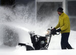 Jeff Clark clears a sidewalk on Tuesday, Feb. 12, 2019, in Appleton, Wis.  The latest snow storm to move through the state dropped several inches of snow overnight. (Wm. Glasheen/The Post-Crescent via AP)