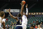 Boise State forward Abu Kigab (24) shoots over Georgia Tech forward Moses Wright (5) during the first half of an NCAA college basketball game Sunday, Dec. 22, 2019, in Honolulu. (AP Photo/Marco Garcia)