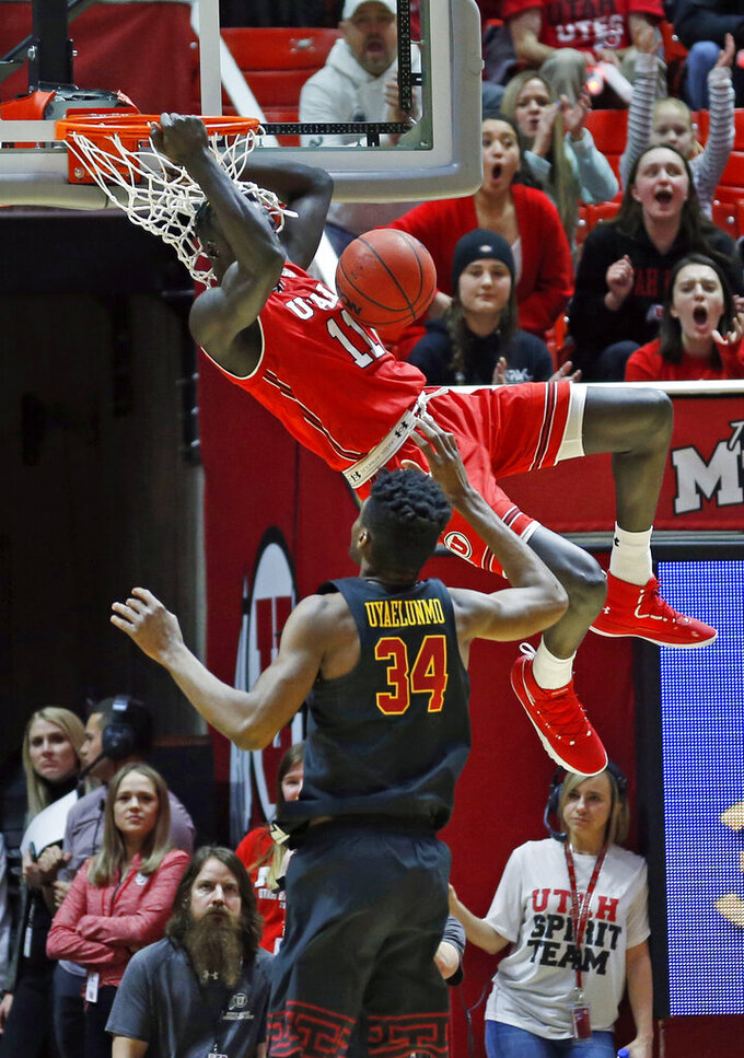 Utah forward Both Gach (11) dunks againstSouthern California forward Victor Uyaelunmo (34) in the first half during an NCAA college basketball game Thursday, March 7, 2019, in Salt Lake City. (AP Photo/Rick Bowmer)