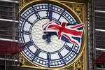 """A Union flag waves against the backdrop of the clock facade of the Elizabeth Tower, which holds the bell known as """"Big Ben"""", in London, Friday, Nov. 1, 2019. British euroskeptic politician Nigel Farage is trying to ramp up the pressure on Conservative Prime Minister Boris Johnson. He warned that his Brexit Party will run against the Conservatives across the country in the Dec. 12 general election unless Johnson abandons his divorce deal with the European Union.  (AP Photo/Alberto Pezzali)"""