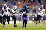 TCU wide receiver Derius Davis (12) breaks away for a long pass reception during the second quarter against Oklahoma State in an NCAA college football game in Fort Worth, Texas, Saturday, Nov. 24, 2018. (Tom Fox/The Dallas Morning News via AP)
