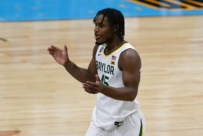 Baylor guard Davion Mitchell (45) celebrates after making a basket during the first half of a men's Final Four NCAA college basketball tournament semifinal game against Houston, Saturday, April 3, 2021, at Lucas Oil Stadium in Indianapolis. (AP Photo/Michael Conroy)