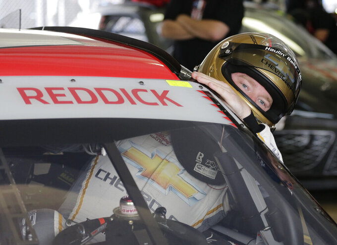 Tyler Reddick gets in his car before a NASCAR Xfinity Series auto race practice on Friday, Nov. 15, 2019, at Homestead-Miami Speedway in Homestead, Fla. Reddick is one of four drivers racing for the series championship. (AP Photo/Terry Renna)