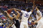 Seton Hall center Romaro Gill (35) knocks the ball from Butler forward Bryce Golden (33) during the first half of an NCAA college basketball game Wednesday, Feb. 19, 2020, in Newark, N.J. (AP Photo/Kathy Willens)