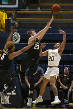 California guard Matt Bradley (20) shoots over Colorado defenders D'Shawn Schwartz (5) and Lucas Siewert (23) during the first half of an NCAA college basketball game Thursday, Feb. 27, 2020, in Berkeley, Calif. (AP Photo/D. Ross Cameron)