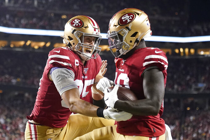 San Francisco 49ers wide receiver Deebo Samuel, right, is congratulated by tight end George Kittle after scoring against the Green Bay Packers during the first half of an NFL football game in Santa Clara, Calif., Sunday, Nov. 24, 2019. (AP Photo/Tony Avelar)