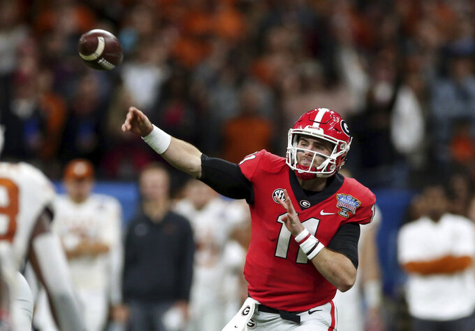 Georgia quarterback Jake Fromm throws a pass during the first half of the team's Sugar Bowl NCAA college football game against Texas in New Orleans, Tuesday, Jan. 1, 2019. (AP Photo/Rusty Costanza)