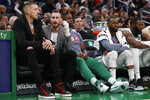 Injured Boston Celtics players Daniel Theis, left, and Gordon Hayward talk on the bench during the second quarter of the team's NBA basketball game against the Washington Wizards on Wednesday, Nov. 13, 2019, in Boston. (AP Photo/Winslow Townson)